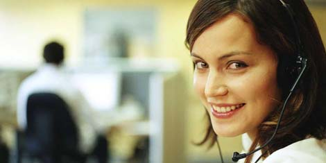 Young woman wearing headset in office, portrait